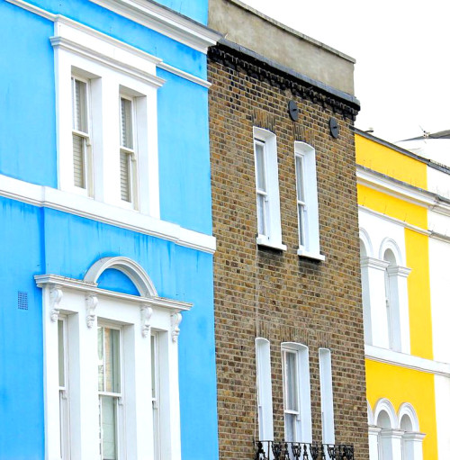 notting hill london bright blue and yellow buildings