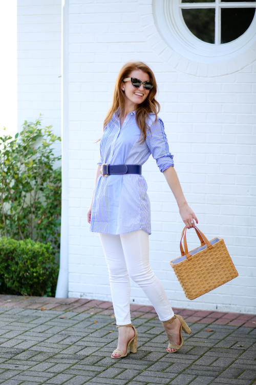 Design Darling's Mackenzie Horan in a J.McLaughlin tunic, navy leather belt, white skinny jeans, straw tote bag, and Steve Madden Carrson sandals.