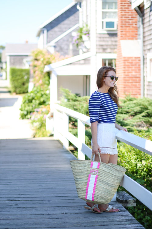 design darling wears a saint james striped shirt and lindroth designs monogrammed bag on nantucket