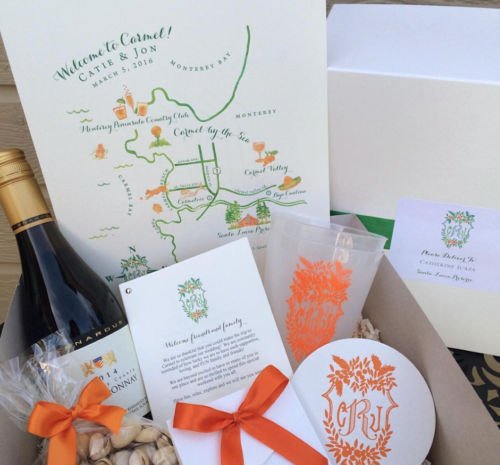 wedding welcome boxes with custom wedding crest and map by kearsley lloyd