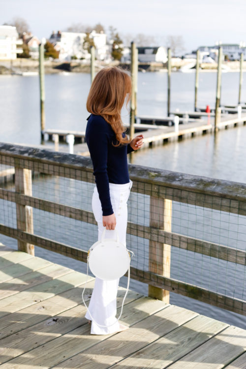 design darling wears ted baker navy bow sweater banana republic white sailor jeans clare v white circle alistair bag