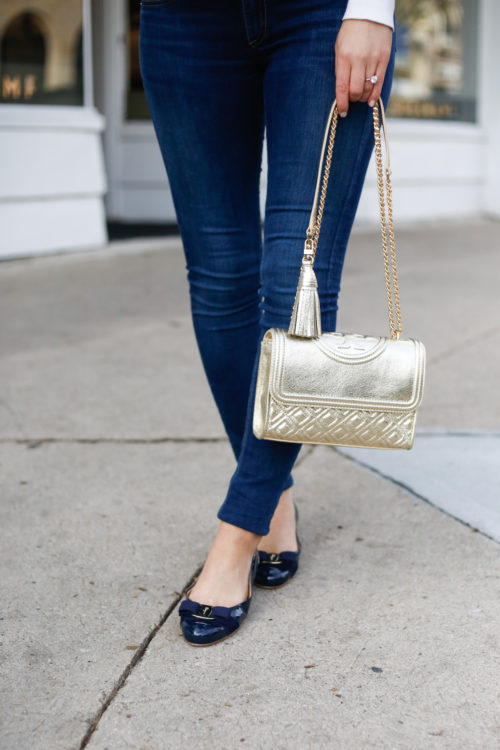 gold tory burch bag and navy ferragamo flats on design darling