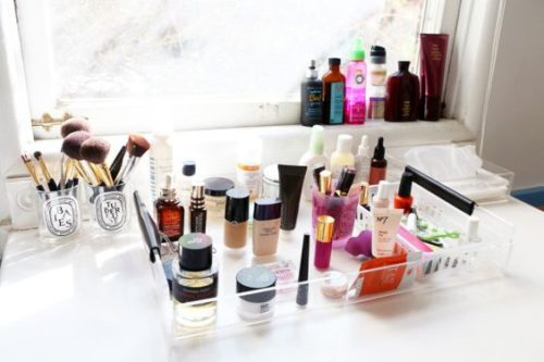 makeup organization with lucite tray and old candles