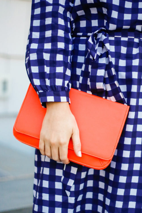 banana republic gingham dress with orange clutch