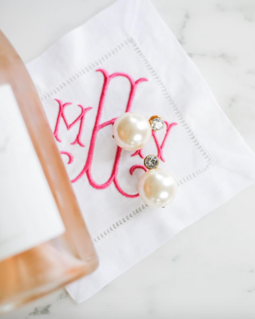 tory burch faux pearl drop earrings and monogrammed cocktail napkins from easy
