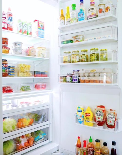 organized fridge with acrylic containers the home edit