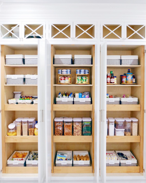 organized pantry with baskets the home edit