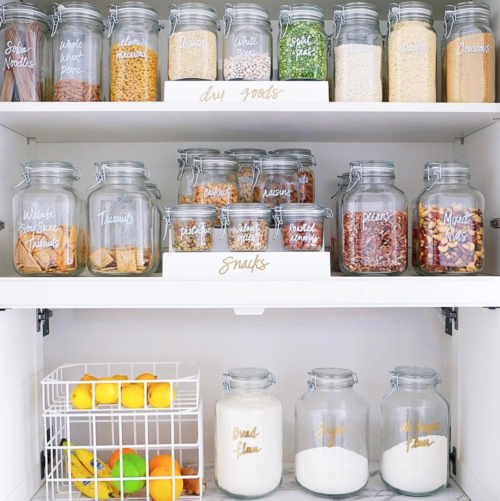 organized pantry with labeled jars the home edit