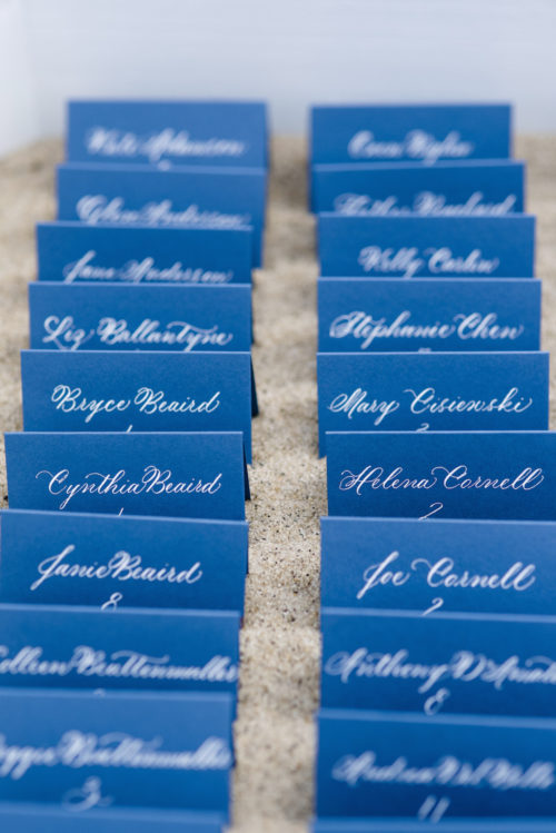 design darling wedding navy escort cards with white calligraphy