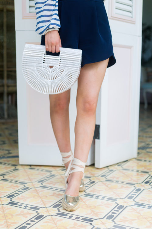 cult gaia mother of pearl ark bag and soludos gold espadrilles