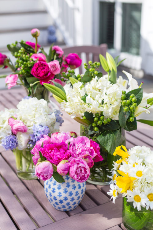 pink peony daisy and daffodil flower arrangements