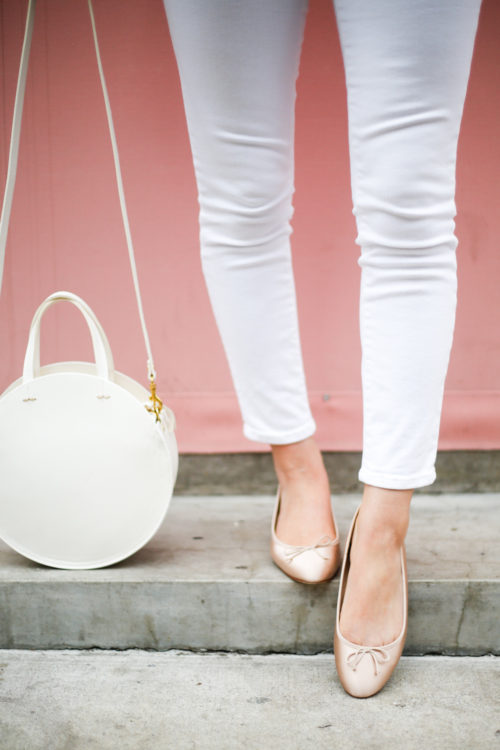 pale pink satin ballet flats from j.crew and white circle bag from clare vivier
