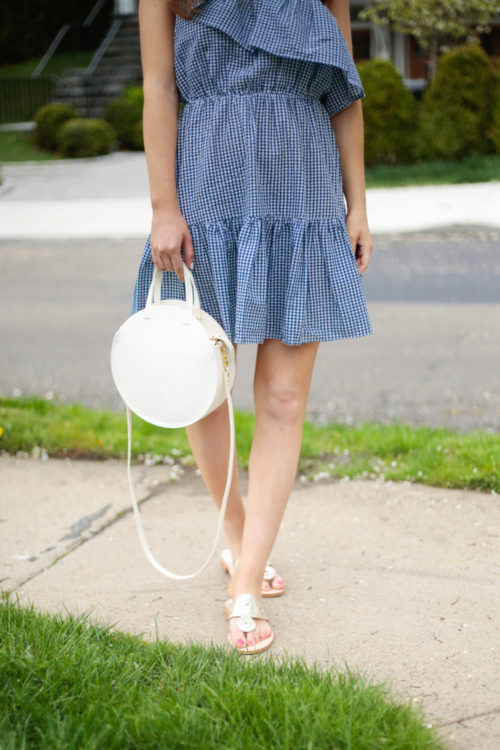 blue gingham one shoulder dress and white circle bag