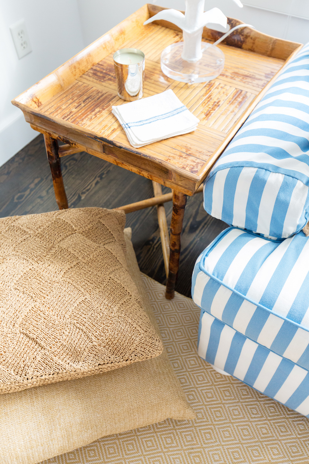 Design Darling Nantucket Living Room With Rattan End Tables Striped Sofas And Raffia Floor Pillows
