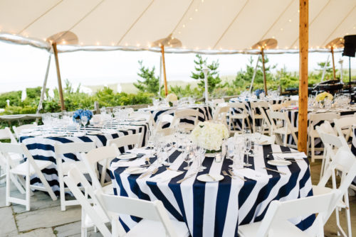 design darling wedding tent with striped tablecloths