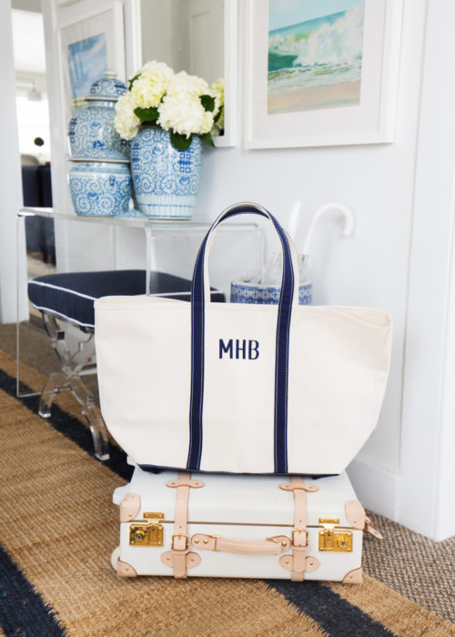 design darling ll bean boat tote and steamline luggage in foyer
