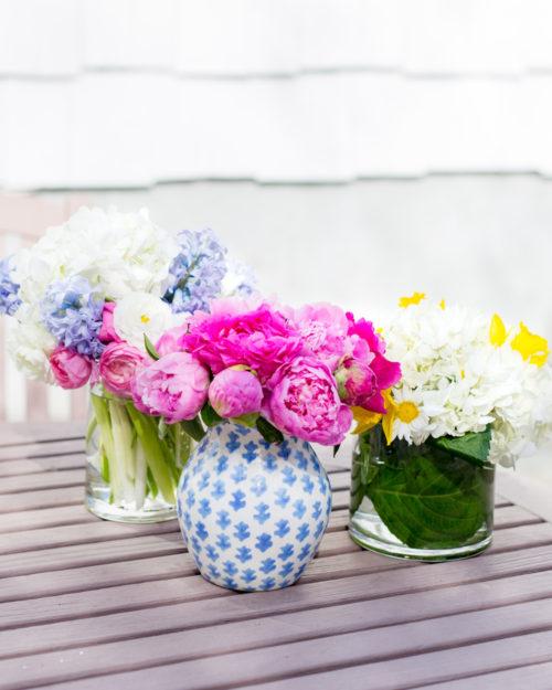 white hydrangeas hyacinth and ranunculus flower arrangement