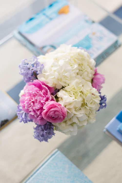 white hydrangeas pink peonies pink ranunculus and hyacinth