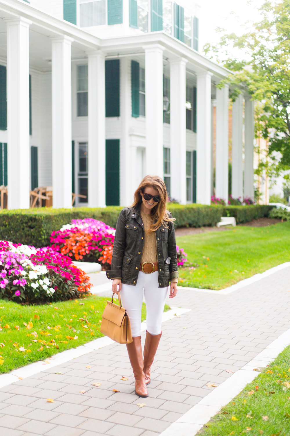 j.crew downtown field jacket and j.crew leather riding boots with white jeans
