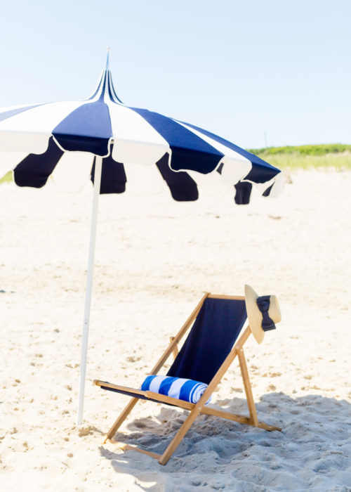 serena & lily eastport striped umbrella and teak sling chair in navy