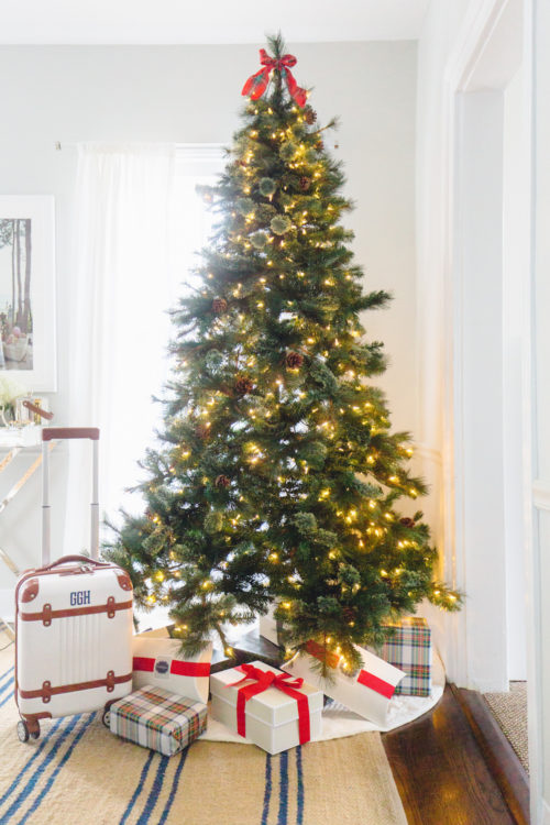 design darling christmas tree with mark & graham terminal 1 carry-on monogrammed suitcase