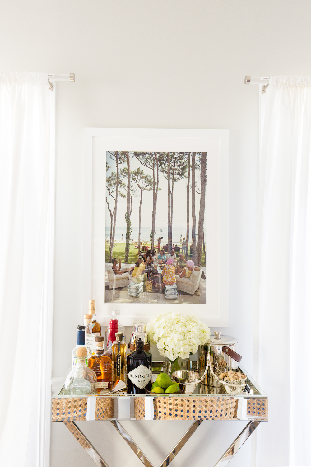 slim aarons print and west elm mirrored bar tray