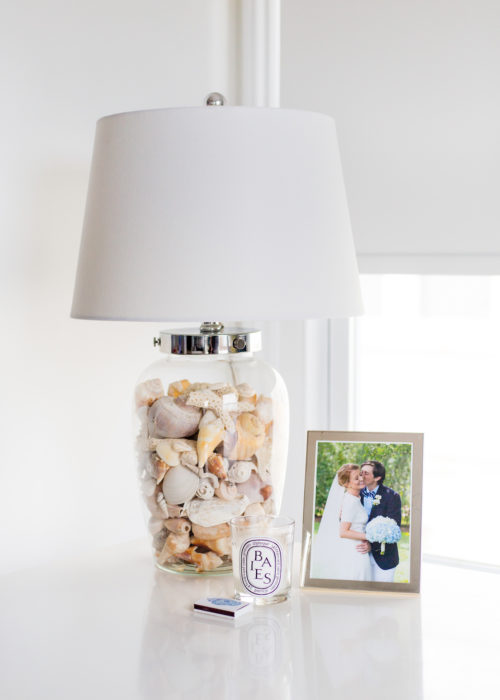 clear lamp filled with shells on design darling