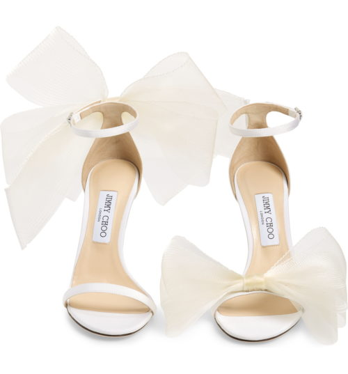 4b13302d2d58 ... has a bow at the toe and the other shoe has a bow at the ankle