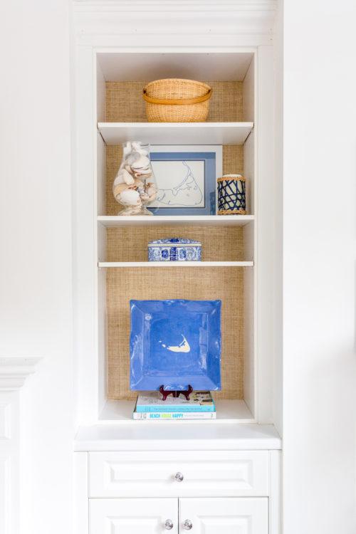grasscloth wallpaper in bookshelves on design darling