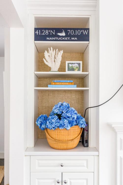 grasscloth wallpapered bookshelves on design darling