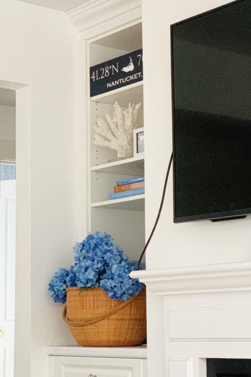wallpapered bookshelves on design darling