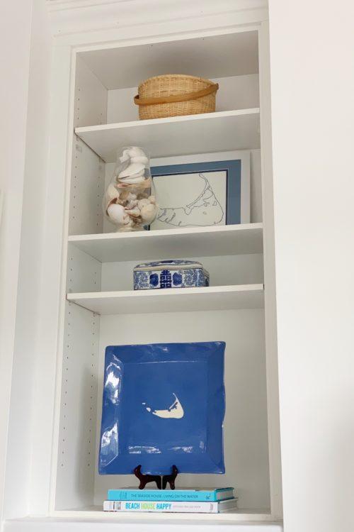 wallpapering bookshelves on design darling