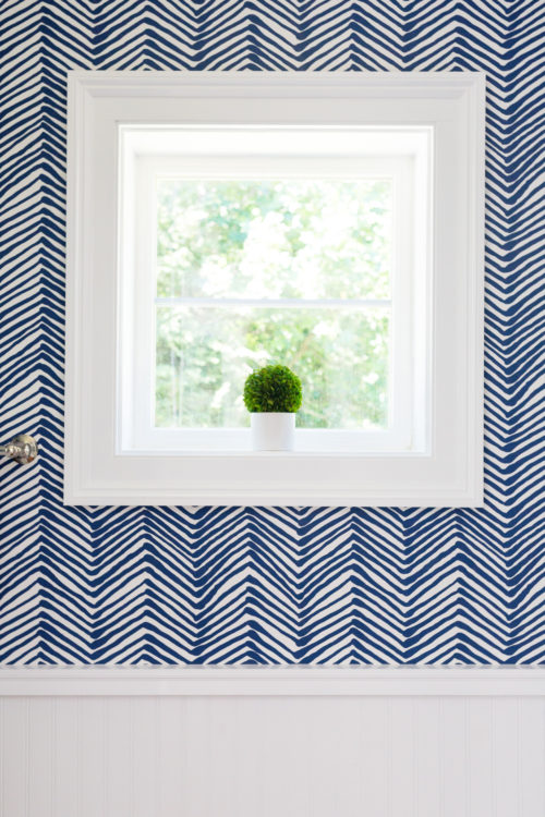 boxwood topiary in quadrille navy zig zag wallpaper powder room