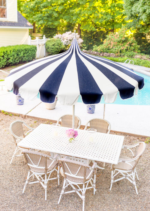 design darling serena & lily eastport striped umbrella wayfair darby home co flagg cast aluminum dining table and serena & lily outdoor riviera dining chair in dune