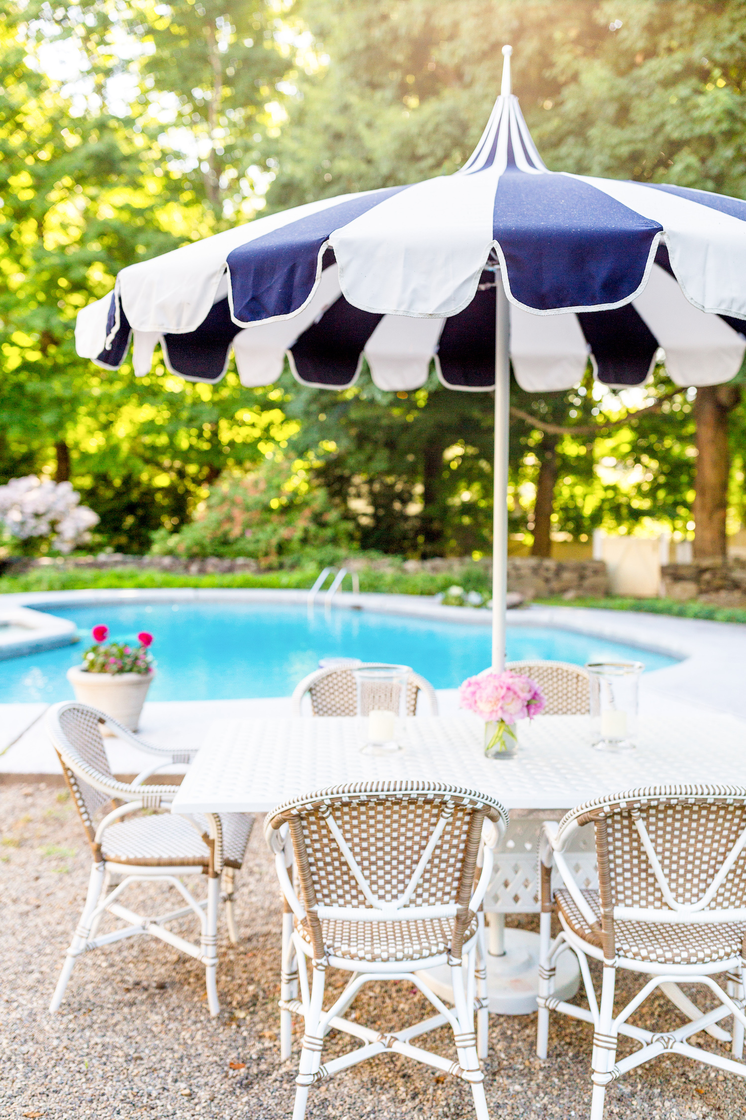 serena & lily eastport striped umbrella wayfair darby home co flagg cast aluminum dining table and serena & lily outdoor riviera dining chair in dune on design darling