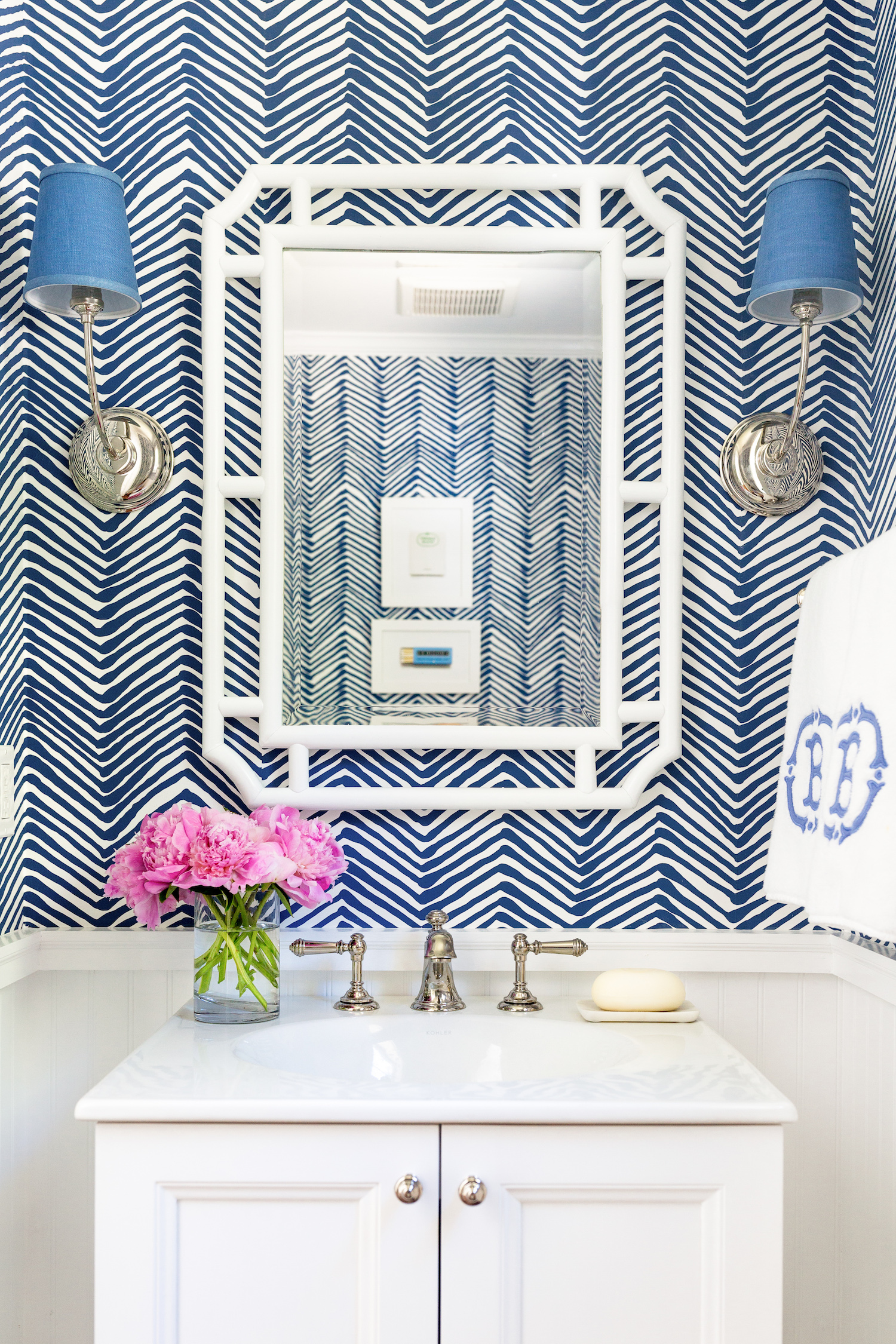 serena & lily ojai mirror on quadrille zig zag wallpaper with visual comfort co vendome single sconce in polished nickel