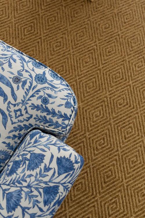 armchair in lee jofa sameera indigo blue fabric on dash & albert cress bark indoor:outdoor custom rug