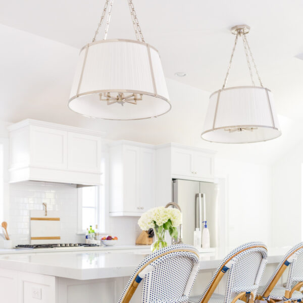 design darling kitchen with ralph lauren windsor large hanging shade and serena & lily riviera counter stools