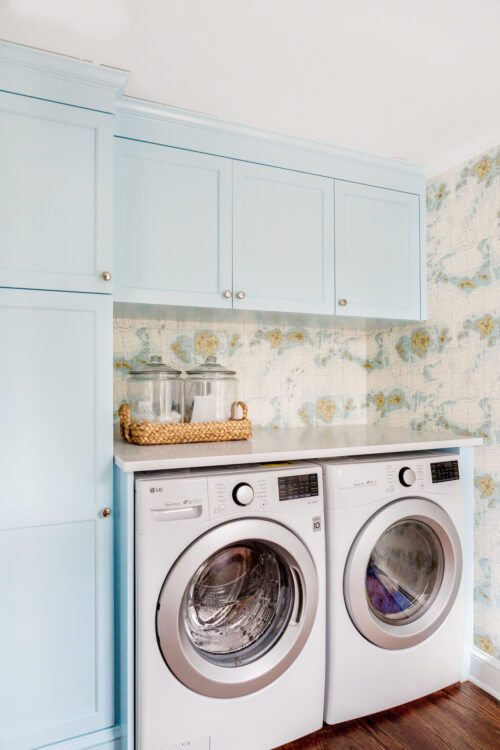design darling laundry room with custom cabinets in sherwin williams crystal stream ralph lauren great har white map wallpaper and lg washer dryer