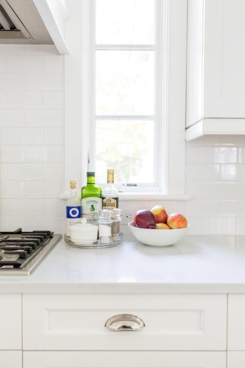 enigma quartz countertop in giza with emtek cup bin pull in bright nickel