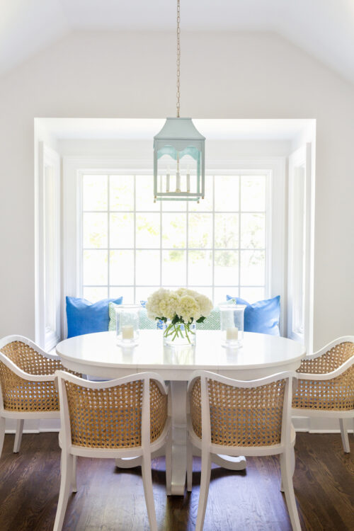 oomph hobe sound lantern in hinting blue with cb2 tayabas cane dining chairs in design darling breakfast nook