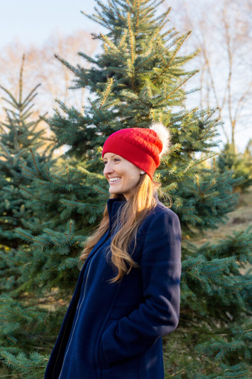 design darling cutting down our own christmas tree red beanie