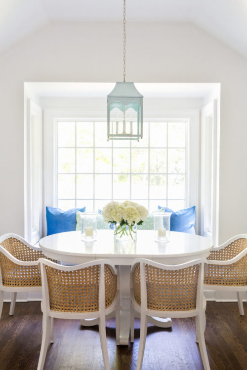 oomph-hobe-sound-lantern-in-hinting-blue-with-cb2-tayabas-cane-dining-chairs-in-design-darling-breakfast-nook-768x1152
