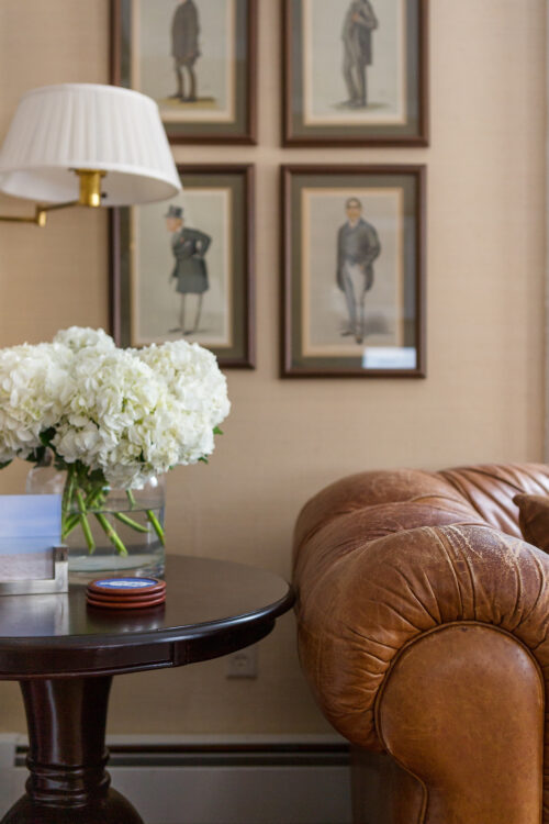 wood pedestal table and chesterfield sofa design darling home office