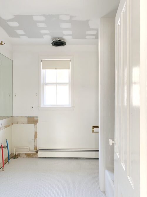 white penny tile design darling hall bathroom remodel