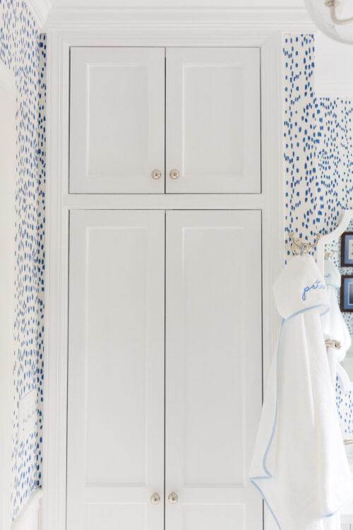 bathroom linen closet with Baldwin Estate 1-1:4 Inch Round Cabinet Knobs