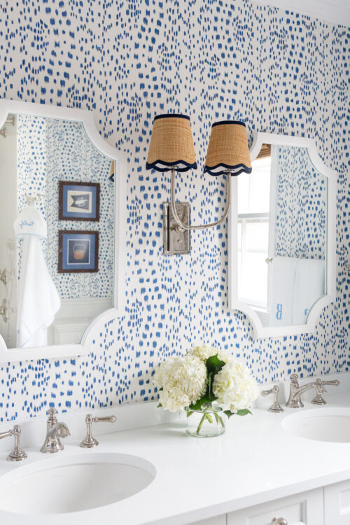 brunschwig & fils les touches wallpaper and visual comfort hulton double sconce in bathroom
