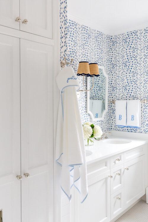 linen closet in bathroom with brunschwig & fils les touches wallpaper
