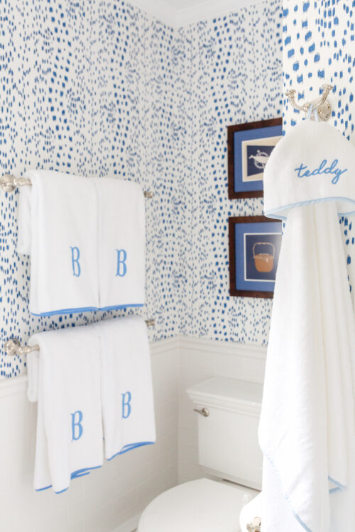 weezie towels piped edge towels and brunschwig & fils les touches wallpaper in bathroom