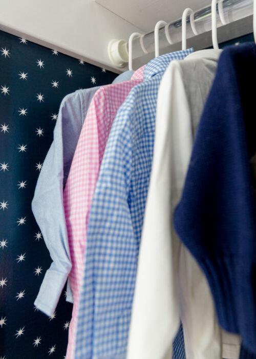 navy star wallpaper in baby boy closet